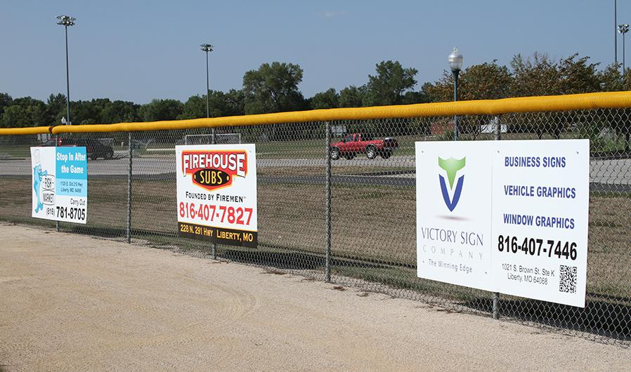 Sponsor signs on fence at FBSC_thumb.jpg